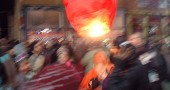 A red lantern bounces among the crowd of revelers New Years Eve on Xenia Avenue. (Photo by Matt MInde)