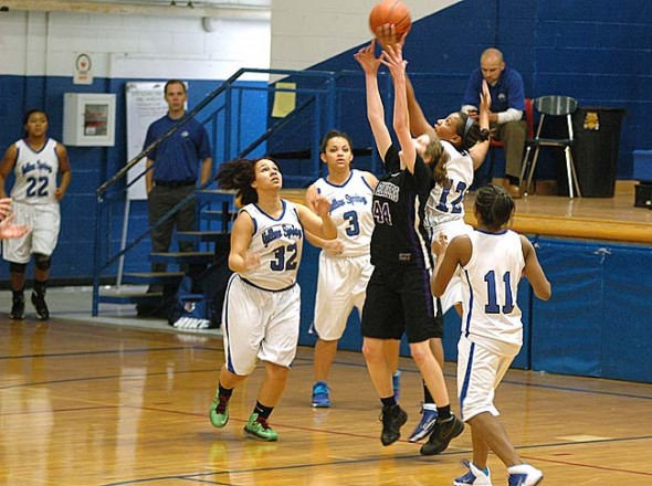 Kennedy Harshaw snatched a rebound over a Landmark Christian player during the YSHS girls basketball team's 54–38 loss at home on Saturday, Jan 18. Harshaw had eight points on the night. Other Lady Bulldogs are, from left, Ashlei' Kelly, Rachele Orme and Brianna Ayers. (Photo by Megan Bachman)