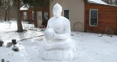 Chris Glaser's snow buddha sits patiently and at peace in the cold, as only the buddha could do. (Photo by Megan Bachman)