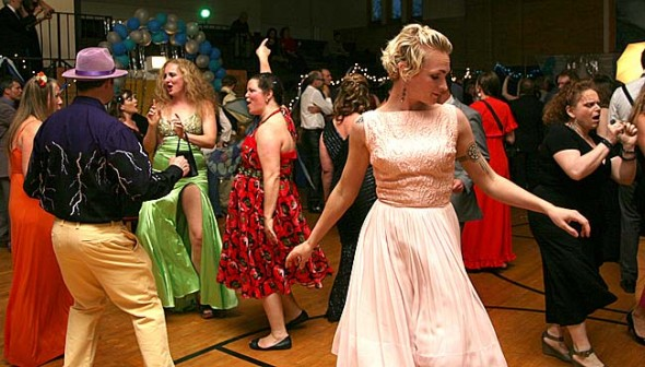 In May about 250 people came dressed in their finest for the village's first adult prom hosted by The Browns Backers at the Bryan Center gym. DJ Dr. Falafel played Madonna, Boyz 2 Men and some dubstep in the effort to raise $2,186 for YSKP's summer program. Twirling across the foreground is Elise Yaskoff. (Photo by suzanne Szempruch)