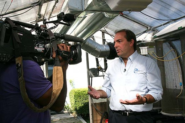 Enviroflight and Antioch College may collaborate on a project to benefit both entities. In the photo, Enviroflight President Glen Courtright is shown being filmed by a CNN cameraman for a segment on that network last fall. (photo by Suzanne Szempruch)