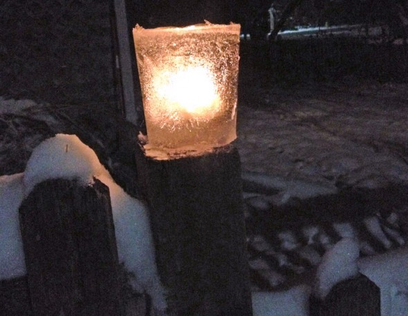 While it's not good for much else, the cold weather is ideal for freezing water. To make an ice candle, such as the one above, simply freeze water between two concentric vessels, remove, and set a votive alight inside. (Photo by Matt MInde)