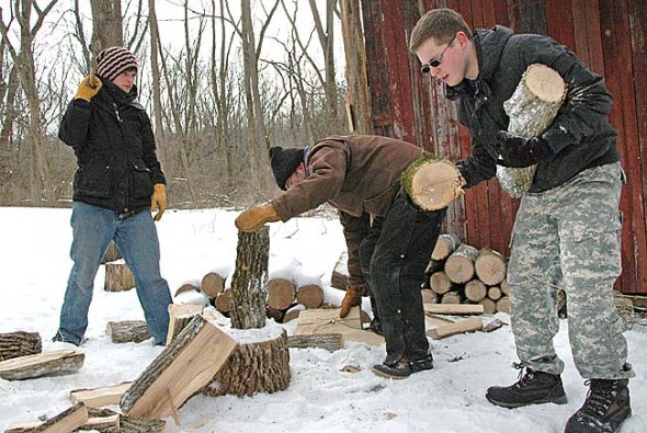 Antioch College students Kelsey Pierson, left, and Khalil Nasar, far right, chopped wood with Glen Helen Nature Preserve Land Manager George Bieri, center, on a recent chilly afternoon in the Glen. Pierson and Nasar are two of 16 Antioch students working this year at local nonprofits as Miller Fellows. (Photo by Megan Bachman)