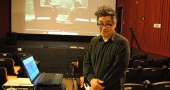 "Local political theorist Kurt Miyazaki, who also owns the Emporium Cafe, gave a talk and showed film clips on the fascist aesthetic in films at the Little Art Theatre on a recent Saturday. Miyazaki, who used to teach a class on film theory and political ideologies at Wittenberg University, was the first speaker in a new Little Art series, ""Let's Talk Movies"" that explores different aspects of filmmaking and cinema. It runs the first Saturday of each month. (Photo by Megan Bachman)"