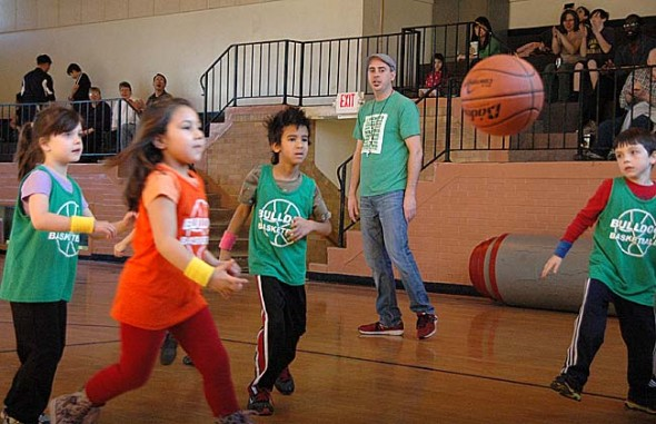 Players scrambled for a loose ball at a Yellow Springs Bulldog Youth Basketball League game last Saturday. From left, Julianna Torres, Mateen Sajabi, referee Matt Housh and Collin Calfee. (Photo by Megan Bachman)