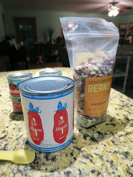 bag of beans and canned tomatoes