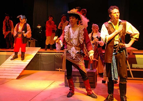 "The Pirate King, center, played by Josh Seitz, and his indentured servant, Frederic (Ben Green), square off in the first scene of ""Pirates of Penzance."" The Yellow Springs High School Drama Club and the YSHS Theatre Arts Association present Gilbert & Sullivan's 19th century comic opera at the Mills Lawn Auditorium on March 14–16 and 21–23.  (photo by Megan Bachman)"