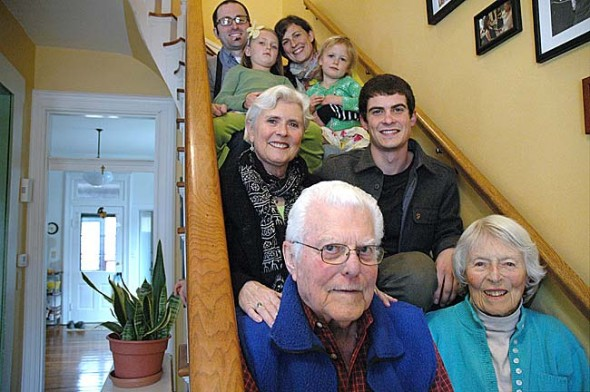 Wally and Evelyn Sikes, foreground, moved to Yellow Springs in the 1950s to live and work in the community. Their children and grandchildren grew up in the village, and though the third generation has returned to raise their own children here, finding local jobs is not as easy as it once was. Pictured behind the elder couple are Linda Sikes and her son Kevin Sikes-Gilbert, as well as her daughter Naomi and son-in-law Chris Bongorno with their children, from left, Nora and Elise. (Photo by Megan Bachman)