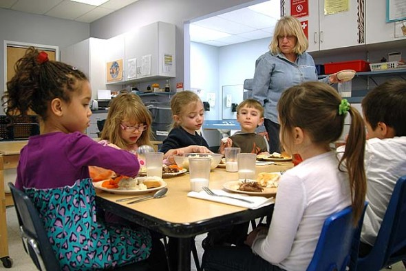Friends Preschool Program teacher Janice Kumbusky serves lunch to students at Friends Care Community, including from left, Elaina Gilley, Cara Rodin-Brewer, Vann Gleadell, Donovan Cooney, Payton Mulley, David Torres. The local school will benefit from a grant the Greene County Educational Service Center received to focus on early childhood mental health intervention. (Photo by Carol Simmons)