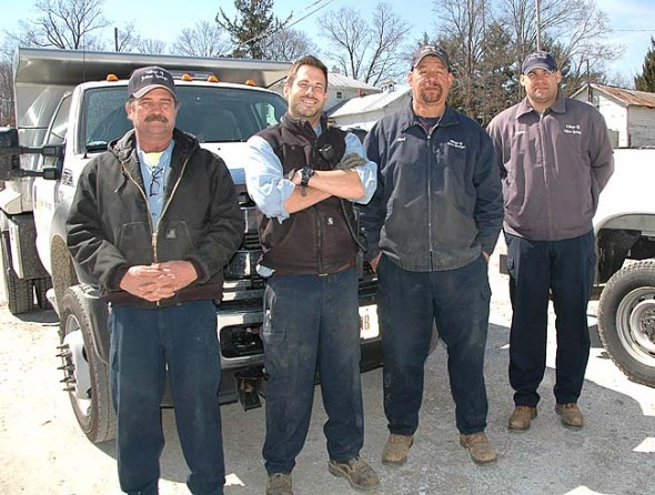 Village road crew members, from left, Scott Gochenouer, Tanner Bussey, Kent Harding and Jason Hamby, spent massive hours behind their plows this winter. Aside from snow removal, the road crew is also responsible for waste water management and maintaining Village buildings and parks and recreation facilities. (Photo by Carol Simmons)