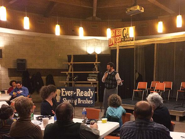 Luke Dennis addresses volunteers
