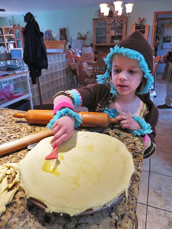 brushing Olive Oil on top