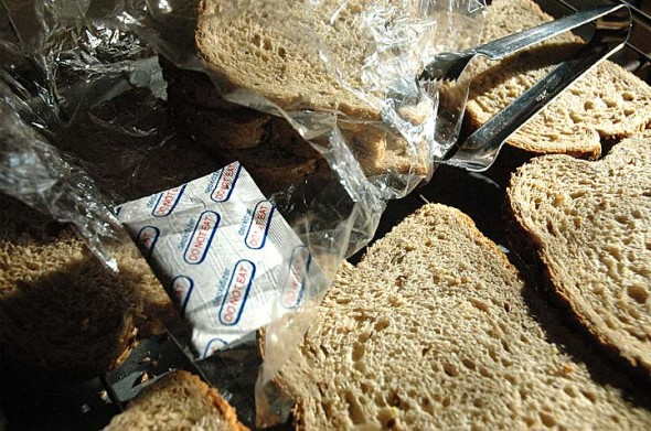 Several slices of EcoToast displayed in their final round of drying on their racks. A desiccant and three plastic bags ensure that the EcoToast's crispy finish remains present after packaging. (Photo by F. Stop Fitzgerald)