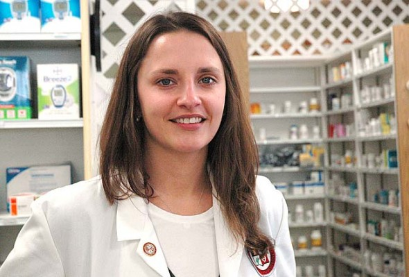 Emma Robinow, whose mentor was the late Tim Rogers, is the new pharmacist at Town Drug. (Photo by Carol Simmons)