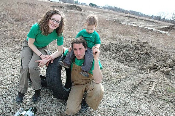 Lauren and Zac Craig recently prepared the land on a property just outside of Clifton to build a passive solar earth-berm Earthship with old tires, discarded glass bottles and other used materials. The start of a series of Earthship construction workshops and work days begins April 12–13  with a weekend workshop on tire foundation. Also pictured is the Craig's son, Elliot.  (Photo by Megan Bachman)