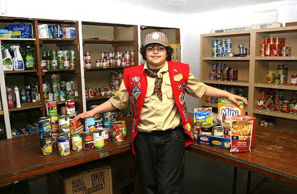 "Mills Lawn fourth-grader C.J. Cooper, a Webelo in Pack 362, recently spent time in Xenia, where many of his other pack members live, ""Scouting for food,"" an annual Boy Scout-led food drive. (Photo by Suzanne Szempruch)"