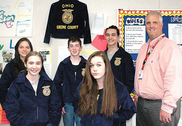 Ohio's newest chapter of the Future Farmers of America Organization: pictured in back are dairy team members Caylen Hall, Landon Rhoads and Tristan Campbell, with Coach Brad Lokai. In front are poultry team members Isabella Long and McKenna Moore. Not pictured are poultry team members Ashley Longshaw, Zane Pergram and Alexandra Snoddy