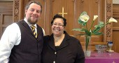 "Celebrating the joining of their churches in worship during the upcoming Holy Week is the Reverend Aaron Maurice Saari of the First Presbyterian Church of Yellow Springs and the Reverend Sherri Blackwell of the Yellow Springs United Methodist Church. Joint activities, which are open to the public, are a ""Jesus Christ Superstar"" sing-a-long on Palm Sunday, a ritual Agape meal on Maundy Thursday and a candlelight service on Good Friday. (Photo by Megan Bachman)"