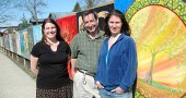 Holly Underwood of the Yellow Springs Arts Council, who organized the Fence Gallery at the Barr property, is shown with two participating artists, Scott Stolsenberg and Bettina Solas. The project, which was the brain child of property owner Jim Hammond, will be up until the fall. (photos by Lauren Heaton)
