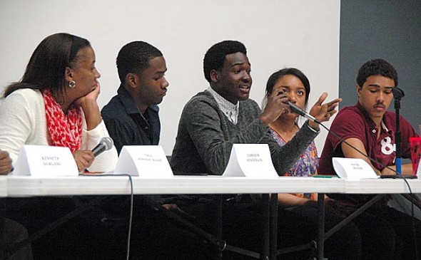 Current and former Yellow Springs High School students spoke about racism in the local schools and how to empower local black youth at a panel discussion April 21 at AU Midwest. Panelists are, from left, Teresa Bondurant-Wagner, Cameron Henderson, Hafiz Mensah, Taylor Beck and Edward Johnson. (photos by Megan Bachman)