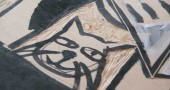 A close up of Sherraid Scott's cat in the center of her board that she's carving as part of the Fence Art Gallery. (photos by Suzanne Szempruch)