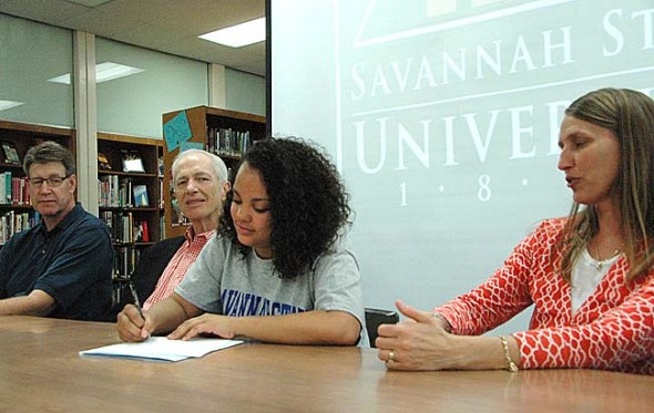Recently Yellow Springs High School senior Rachele Orme signed her National Letter of Intent to play Division I golf at Savannah State University, a historically black college in Georgia. Orme is the first female golfer in YSHS history to play in college. The two-time district qualifier played mostly against boys during high school. Orme received a partial scholarship from Savannah State and looks forward to competing against some of the best girls in the country, she said at the signing ceremony. Next to Orme are her parents, Jim Orme and Naomi Ewald-Orme, and on the far left is former YSHS golf coach Mike Reichert. (Photo by Megan Bachman)