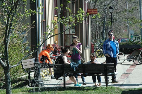 Tourists by the old railroad station Chamber of Commerce in Yellow Springs. (Photo by Carol Simmons)