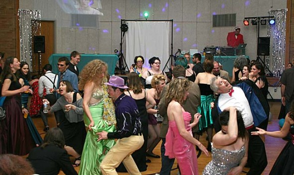 """Last year's """"Enchantment Under the Springs"""" adult prom drew a sell-out crowd of 200 people wearing their cheesiest prom attire. Tickets are on sale now for the second annual adult prom, 7 p.m. to midnight Saturday, May 10, at the John Bryan Center gymnasium, 100 Dayton St. This year's theme is """"Hollywood Edition."""" (Photo by Suzanne Szempruch)"""