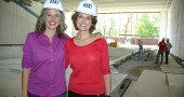 Newly hired Antioch College Wellness Center Director Monica Hasek, left, and Project Lead Dorothy Roosevelt beside the center's almost-completed pool, in the natatorium that features a wall of windows on the south side, with a patio beyond. The center is scheduled to be completed in late summer or early fall. (Photo by Diane Chiddister)
