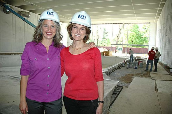 Monica Hasek, left, the new director of the Antioch College Wellness Center, and project lead Dorothy Roosevelt stand near the facility's almost-completed new pool. The center is expected to open in late summer or early fall.