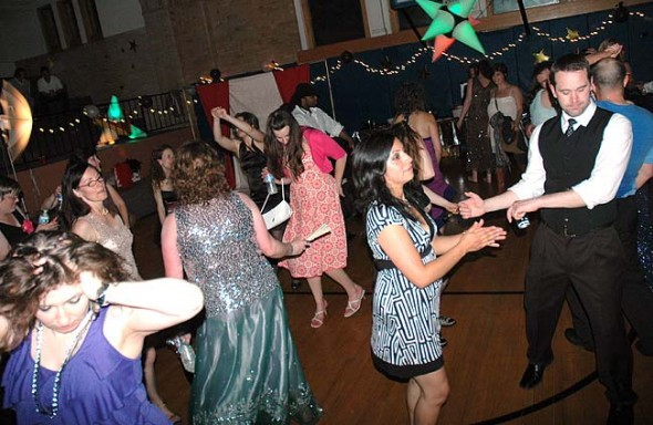 Around 180 villagers, including Minerva and Alex Bieri, at right, donned their most glamorous attire for the Hollywood-themed Yellow Springs Adult Prom on Saturday night and danced the night away. (photos by Megan Bachman)