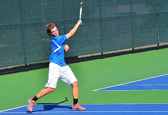 Freshman tennis star Augie Knemeyer at a first singles match he won against a Beavercreek opponent earlier this month. Knemeyer won three straight matches at last week's sectionals to qualify for districts. (Submitted photo by Michael Knemeyer)