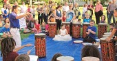 """At last Friday's exhibition of the school-wide Project Peace Initiative at Mills Lawn School, music teacher Jo Frannye Reichert led third-graders in a conga drum performance, as part of D.R.U.M Code, which stands for """"discipline, respect and unity through music."""" (Photo by Megan Bachman)"""