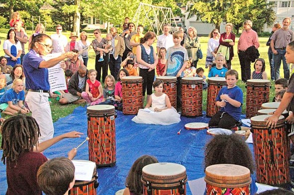 "At last Friday's exhibition of the school-wide Project Peace Initiative at Mills Lawn School, music teacher Jo Frannye Reichert led third-graders in a conga drum performance, as part of D.R.U.M Code, which stands for ""discipline, respect and unity through music."" (Photo by Megan Bachman)"