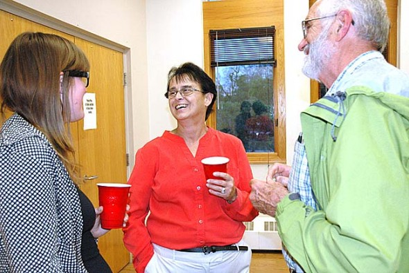 Patti Bates, center, has been chosen as the new Yellow Springs Village manager, beginning on July 7. She is shown here during the reception following the May 22 candidate forum, with Rose Pelzl and Harvey Paige. (Photo by Diane Chiddister)