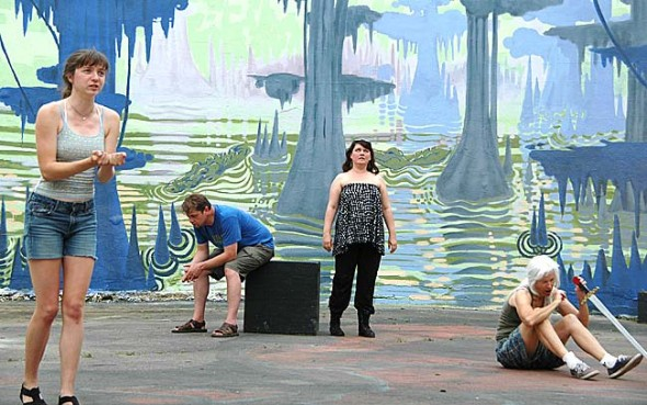 """Charlotte Walkey, left, gave an impassioned monologue as Joan of Arc during a rehearsal for """"D'Arc Comedy,"""" a play that opens at the Antioch Amphitheatre at 8 p.m. Saturday, May 31. Behind Joan, looking on unimpressed by her speech, are the saints of her visions, St. Michael (Thor Sage), St. Catherine (Miriam Eckenrode-Saari) and St. Margaret (Ali Thomas). """"D'Arc Comedy"""" is the first production of the new Yellow Springs Theater Company. (Photo by Megan Bachman)"""