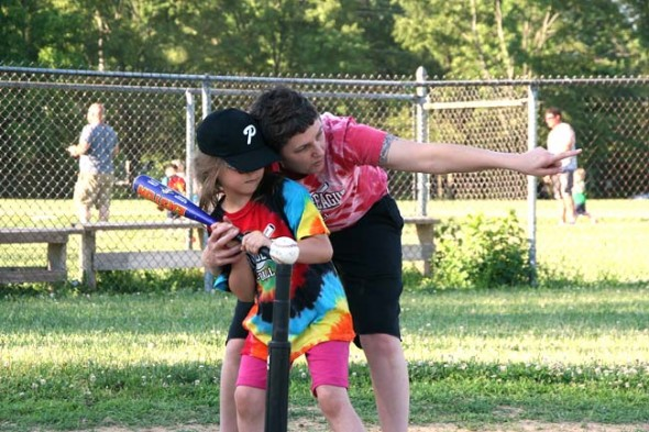 Parent Geneva Gano helped coach batter Lily Kibblewhite on the older kids' diamond. (photo by Suzanne Szempruch)