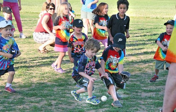 Kids scrambled after a ball at a recent Perry League t-ball Friday evening event.