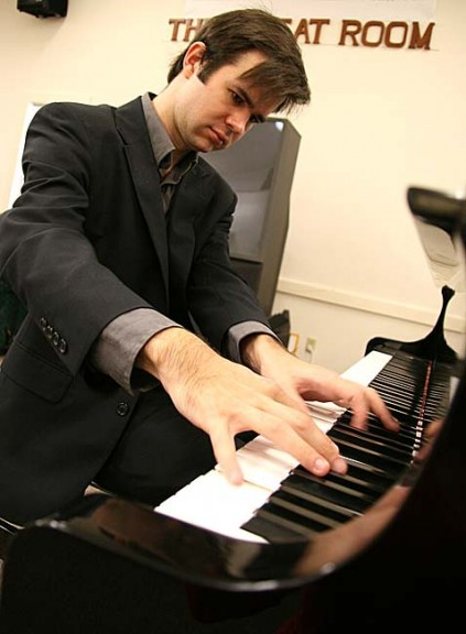 Pianist Sam Reich has this year performed six fundraising concerts for the Yellow Springs Senior Center, where he practices each morning. He and Martin Bakari will perform another benefit concert on Aug. 10. (photo by Suzanne Szempruch)