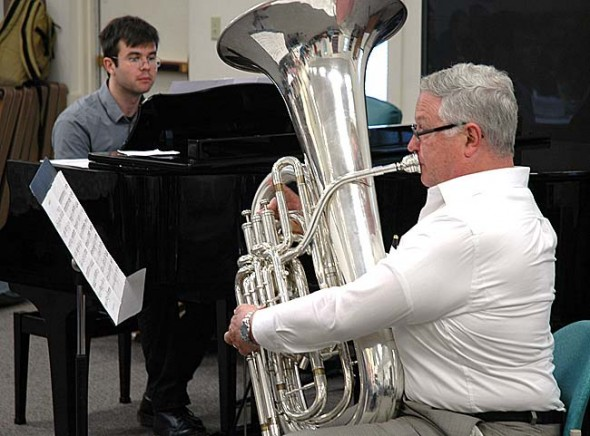 Hans Marlette performed on the tuba last Thursday, June 19, at the Yellow Springs Senior Center's Third Thursday Potluck. Accompanying him is pianist Sam Reich, a Senior Center regular.  (Photo by Matt Minde)