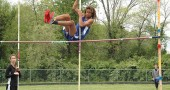 YSHS track and field star Oluka Okia leaped over the pole vault bar during the Metro Buckeye Conference championships at Yellow Springs High School on May 17. Okia went on to win the conference title in the high jump (5'8'') to help propel the YSHS boys team to a second-place finish. The girls team also came in second. The track season ended this week. (Photo by Megan Bachman)