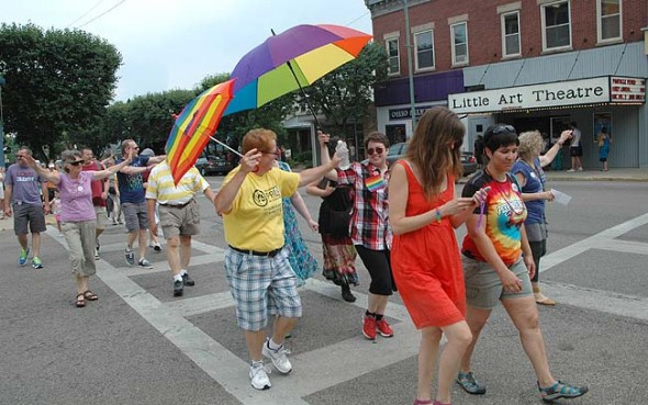 Penny Abamson, left, and Emily Seibel, under umbrellas during the Pride Parade. (photo by Diane Chiddister)