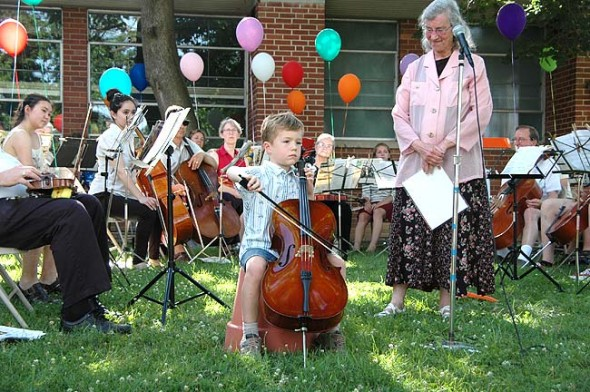 "Shirley Mullins' youngest student, Quentin Branlat, 6, played a measured and tonal ""Twinkle Twinkle Little Star"" on a quarter size cello while staring straight at his audience the entire performance. (photos by Lauren Heaton)"