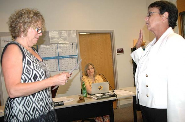Village Council President Karen Wintrow swore in Patti Bates as the new Village manager at Council's July 7 meeting.