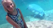 Mackenzie Horton, age 9, is raising money to help rehabilitate manatees, which are often injured by boats. She's shown at the Columbus Zoo.