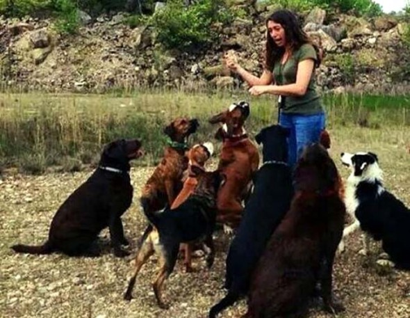 Local resident Becky Teilhet, who died after being struck by lightning in Colorado July 11, is shown here with some of her beloved canine friends. (Submitted photo)
