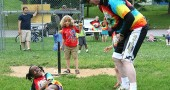 Lidija Lackovich-Van Gorp shared a moment with Coach Jimmy Chesire at last Friday night's T-ball game, while Erasmus Thornton patiently waited his turn at bat. Perry League t-ball takes place this Friday at Gaunt Park at 6:30 and winds up the summer next Friday, Aug. 8, with the annual potluck and trophy give-away. (Photo by suzanne Szmepruch)