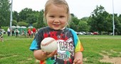 Sophia Purdin, age 3, proudly showed off one of the many baseballs she chased at last week's T-ball. (Photos by Suzanne Szempruch)