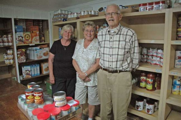 Patty McAllister, center, who has led the Yellow Springs Area Food Pantry for eight years, will step down next year, as pantry board members, including Sue Dillon and Bob Baldwin, seek to fill the gap and recruit new volunteers from the wider community. (photo by Lauren Heaton)