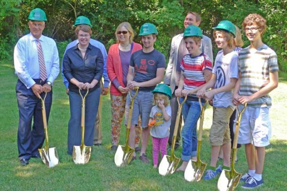 From left are Phil Tuesink of Huntington National Bank, Home, Inc. Executive Director Emily Seibel, Tom Ciresi of the Federal Home Loan Bank of Cincinnati (obscured), Council member Lori Askeland, Caleab Wyant, Council member Brian Housh, Erica Wyant, Calum Wyant, Lori Kuhn of the Morgan Family Foundation (obscured) and Ziven Wyant. (photo by Megan Bachman)